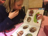 Gillian selecting dishes